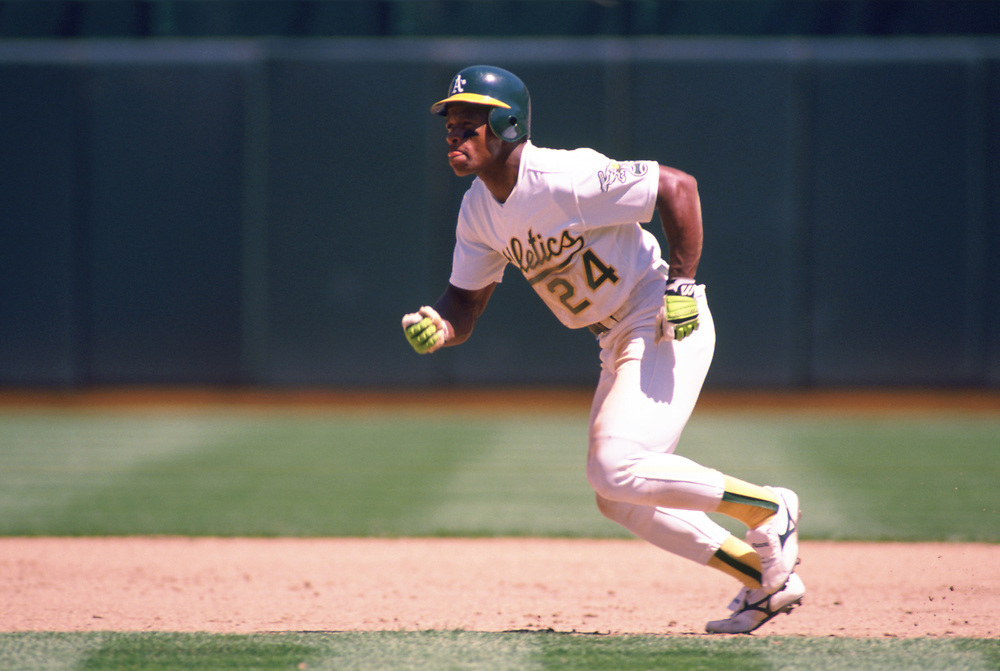OAKLAND - 1989:  Rickey Henderson of the Oakland Athletics runs the bases during an MLB game at the Oakland-Alameda County Coliseum during the 1989 season. (Photo by Ron Vesely).  Subject:   Ivan Rodriguez