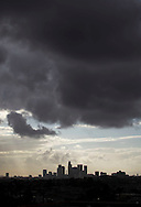Storm clouds pass over the downtown Los Angeles skyline on Wednesday, October 9, 2013. The first rainstorm of the fall doused much of the Southland, prompting residents to break out their umbrellas and in some cases bringing traffic to a crawl. (Photo by Ringo Chiu/PHOTOFORMULA.com)