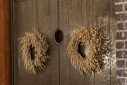 December 21, 2017 - Charleston, South Carolina, United States of America - A wooden door on a historic home decorated with a Christmas wreath made from Sea Oats in Charleston, SC. (Credit Image: © Richard Ellis via ZUMA Wire)