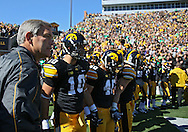 September 22 2012: Iowa Hawkeyes head coach Kirk Ferentz stands with his team prior to taking the field before the start of the NCAA football game between the Central Michigan Chippewas and the Iowa Hawkeyes at Kinnick Stadium in Iowa City, Iowa on Saturday September 22, 2012. Central Michigan defeated Iowa 32-31.