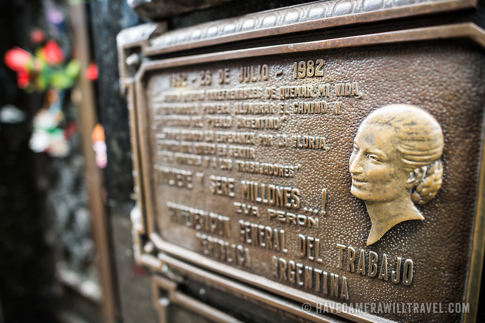 The marker of the gravesite of Eva Peron, a former first lady of Argentina and beloved national figure. La Recoleta Cemetery is a famous cemetery in the Recoleta neighborhood of Buenos Aires and is famous for being the burial sites of Eva Peron, Argentinian presidents, and other notables. The cemetery features above-ground gravesites and crypts and is organized into a series of streets and boulevards.