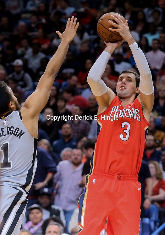 Apr 11, 2018; New Orleans, LA, USA; New Orleans Pelicans forward Nikola Mirotic (3) shoots over San Antonio Spurs forward Kyle Anderson (1) during the first quarter at the Smoothie King Center. Mandatory Credit: Derick E. Hingle-USA TODAY Sports