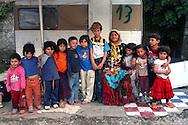 Rome May 2007.Rom's camp Casilino 900.Grandmother and Grandchildren Roma Bosnians.