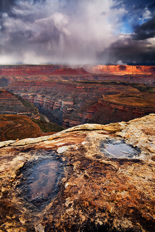 Spring storms roll across Cedar Mesa filling the long-dry pot holes with rain water. The San Juan River can be seen below.