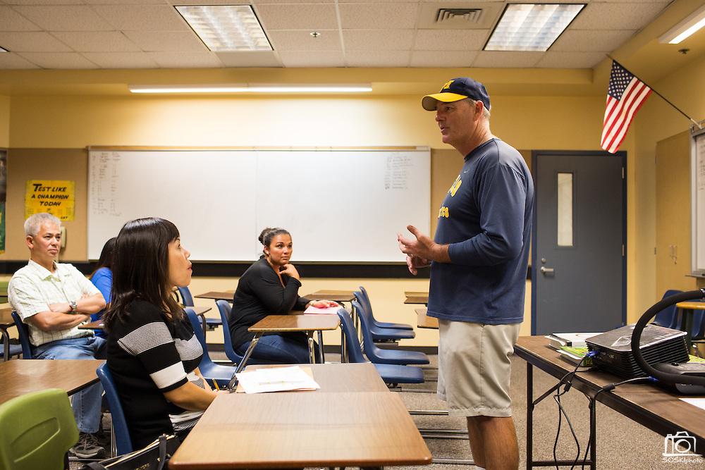 Math teacher and football coach Kelly King reviews course materials during Milpitas High School's Back to School Night at Milpitas High School in Milpitas, California, on September 1, 2015. (Stan Olszewski/SOSKIphoto)