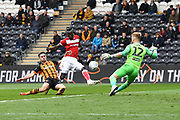 Bristol City striker Famara Diedhiou (9) takes a shot at goal but goes over the bar during the EFL Sky Bet Championship match between Hull City and Bristol City at the KCOM Stadium, Kingston upon Hull, England on 5 May 2019.