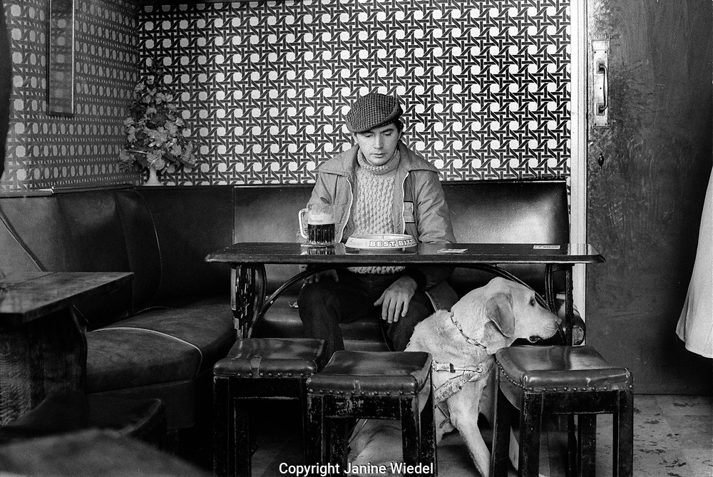 Blind man and his dog in pub in Stown of Shilden in County Durhan in the North of England where unemployment hit hard in the mid-1980s