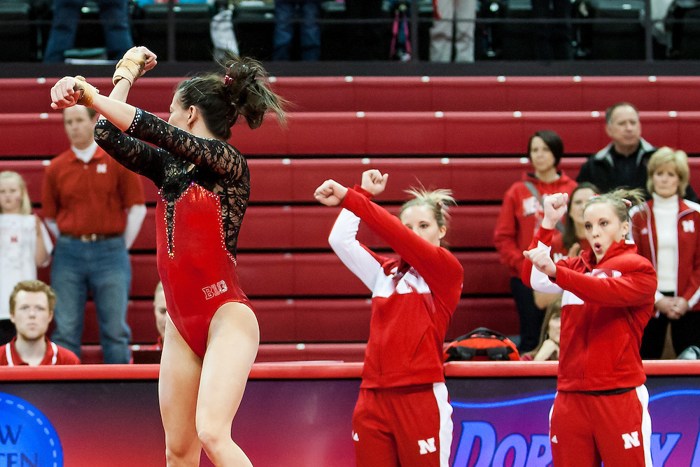February 1, 2014: While Nebraska's Emily Wong performs on the floor teammates  Amanda Lauer and Jennifer Lauer perform the Emily's moves in the dual between Minnesota and Nebraska at the Devaney Sports Center in Lincoln, Nebraska.