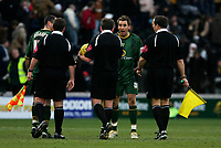 Photo: Andrew Unwin.<br />Hull v Norwich City. Coca Cola Championship. 11/02/2006.<br />Norwich's Darren Huckerby (R of C) continues to argue with the officials.