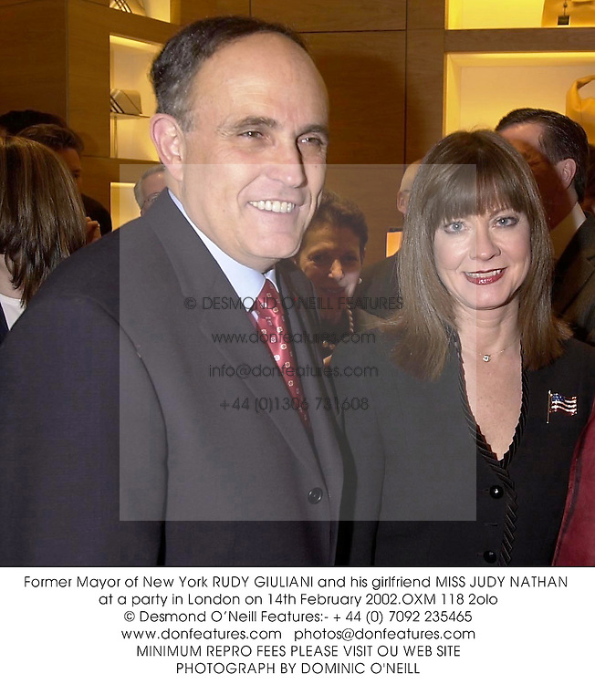 Former Mayor of New York RUDY GIULIANI and his girlfriend MISS JUDY NATHAN at a party in London on 14th February 2002.	OXM 118 2olo