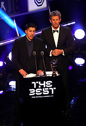 Edwin van der Sar (right) and Chapecoense crash survivor Jackson Follmann present the Best FIFA Goalkeeper Award during the Best FIFA Football Awards 2018 at the Royal Festival Hall, London. PRESS ASSOCIATION Photo. Picture date: Monday September 24, 2018. See PA story SOCCER Awards. Photo credit should read: Tim Goode/PA Wire