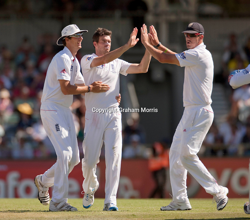 Bowler James Anderson (centre) celebrates his 200th Test wicket (Peter Siddle) during the third Ashes test match between Australia and England at the WACA (West Australian Cricket Association) ground in Perth, Australia. Photo: Graham Morris (Tel: +44(0)20 8969 4192 Email: sales@cricketpix.com) 18/12/10