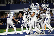 Dallas Cowboys cornerback Jourdan Lewis (27) celebrates with teammates after intercepting a late fourth quarter pass and running it back 7 yards to the New Orleans Saints 16 yard line during the NFL week 13 regular season football game against the New Orleans Saints on Thursday, Nov. 29, 2018 in Arlington, Tex. The Cowboys won the game 13-10. (©Paul Anthony Spinelli)