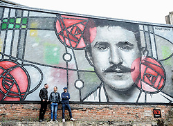 Pictured: Raddisson RED curator Michael Weston (left), Art Pistols Projects founder Ali Smith (middle) and artist Bob McNamara aka Rogue One with the mural.<br /> <br /> A giant street mural, inspired by the work of Charles Rennie Mackintosh, by Art Pistols Projects and artist Rogue-One has been unveiled in Glasgow City Centre. <br /> &copy; Dave Johnston / EEm