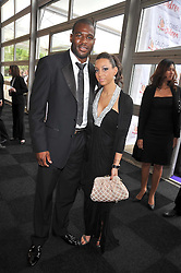 England Rugby player UGO MONYE and ROSIE COLICCI at The Butterfly Ball in aid of the Caudwell Children Charity held in Battersea park, London on 14th May 2009.