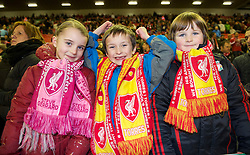 LIVERPOOL, ENGLAND - Wednesday, December 15, 2010: Three young Liverpool supporters before the UEFA Europa League Group K match against FC Utrecht at Anfield. Under-16's were allowed in for free with adults. (Photo by: David Rawcliffe/Propaganda)