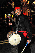 A reveler at the Grand Procession on New Year's Eve in Austin Texas as part of the First Night 2009 celebration, December 31, 2008. First Night is an annual celebration of the arts  held on New Year's Eve in Austin Texas.