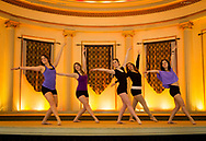 Five women dance in the Great Hall in Memorial Union in 2013, prior to the renovations to the building. The space is used for events, weddings, and sometimes ballroom dancing or dance rehearsals.