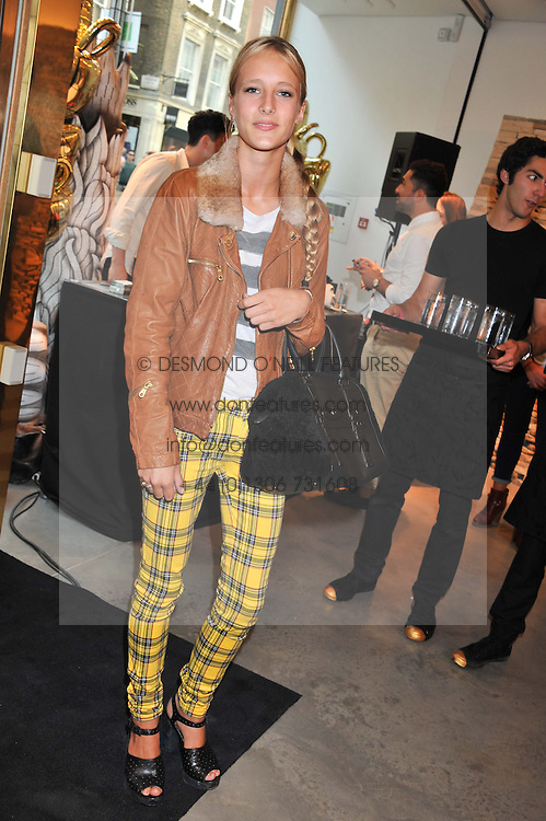 OLYMPIA CAMPBELL at a party to celebrate the launch of the Vogue Fashion's Night Out held at Mulberry, Bond Street, London on 6th September 2012.
