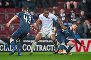 Uche Ikpeazu (#19) of Heart of Midlothian holds off Craig Slater (#17) of Partick Thistle FC during the William Hill Scottish Cup quarter final replay match between Heart of Midlothian and Partick Thistle at Tynecastle Stadium, Gorgie, Edinburgh Scotland on 12 March 2019.