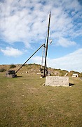 Antique crane forming monument to the quarrying heritage as the Home of Portland Stone, Isle of Portland, Dorset, England