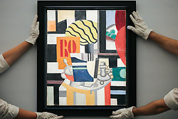 © Licensed to London News Pictures. 29/01/2020. London, UK. Technicians hang Fernand Leger's painting titled Nature Morte (est £2.2m to £2.8m) at the preview of Sotheby's Impressionist, Modern and Surrealist art sales. The auction will take place at Sotheby's in central London on 4 and 5 February 2020. Photo credit: Dinendra Haria/LNP