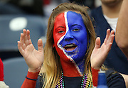 A Houston Texans fan with a painted face cheers for her team during the NFL football game against the Seattle Seahawks on December 13, 2009 in Houston, Texas. The Texans won the game 34-7. ©Paul Anthony Spinelli