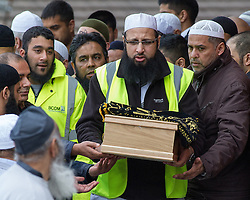© Licensed to London News Pictures . 22/05/2013 . Bolton , UK . Alia's coffin is brought out of the Zakaria Mosque , following the service . Burial prayers for Baby Alia today (Wednesday 22nd May) whose body was discovered abandoned shortly before 4.55pm on Thursday March 14 in Ox Hey Lane , Lostock , near Bolton , by a man and woman out walking their dog . She was wrapped in clothes and a carrier back with a note requesting an Islamic burial . Police say the girl was born alive . They are yet to identify who her mother is . Photo credit : Joel Goodman/LNP