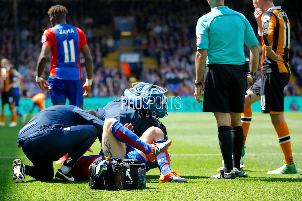 Crystal Palace midfielder Yohan Cabaye received treatment after conceding a foul on the edge of the box during the Premier League match between Crystal Palace and Hull City at Selhurst Park, London, England on 14 May 2017. Photo by Andy Walter.