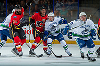 PENTICTON, CANADA - SEPTEMBER 10: Brock Boeser #6 of Vancouver Canucks is checked by Mark Jankowski #77 and Hunter Smith #71 of Calgary Flames on September 10, 2017 at the South Okanagan Event Centre in Penticton, British Columbia, Canada.  (Photo by Marissa Baecker/Shoot the Breeze)  *** Local Caption ***