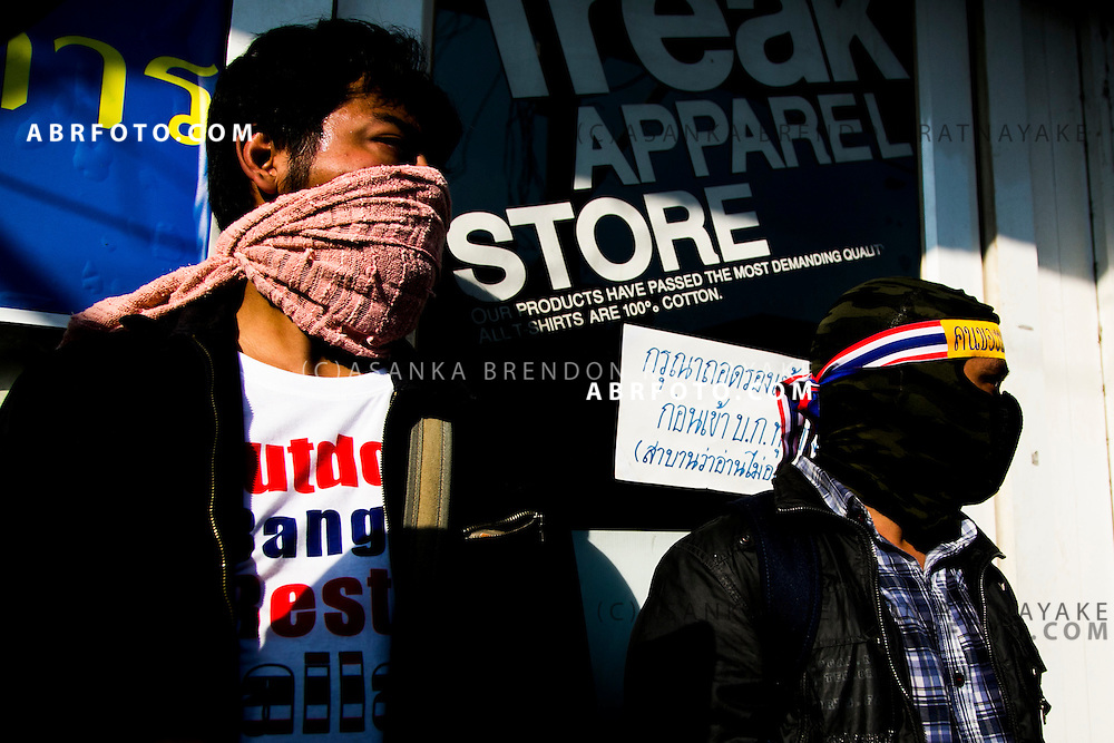 Anti-Government protestors guard a door of the alledged suspect whom threw an explosive device injuring 30 people during an anti-government street rally on January 17, 2014 in Bangkok, Thailand