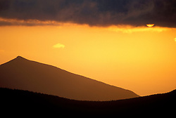 Appalachian Trail. The sun sets opposite Mt. Garfield in NH's White Mountains.  From Mt. Guyot, NH