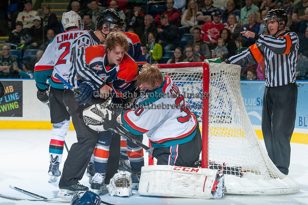 KELOWNA, CANADA - DECEMBER 27: Aspen Sterzer C #11 of the Kamloops Blazers gets tangled up with Jordon Cooke #30 of the Kelowna Rockets on December 27, 2013 at Prospera Place in Kelowna, British Columbia, Canada.   (Photo by Marissa Baecker/Shoot the Breeze)  ***  Local Caption  ***
