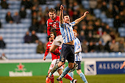 Walsall forward Tom Bradshaw  fouls Coventry City defender Chris Stokes  during the Sky Bet League 1 match between Coventry City and Walsall at the Ricoh Arena, Coventry, England on 12 January 2016. Photo by Simon Davies.