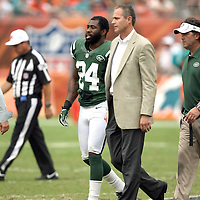 New York Jets cornerback Darrelle Revis (24) leaves the playing field during the second half of an NFL football game against the Miami Dolphins at SunLife Stadium in Miami, Florida. Revis has a torn anterior cruciate ligament in his left knee that will require surgery, likely meaning he'll miss the rest of the season, the team announced Monday, Sept. 24, 2012. (AP Photo/Alex Menendez)