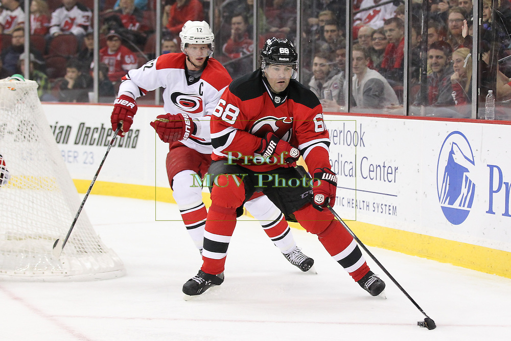 New Jersey Devils right wing Jaromir Jagr (68) is trailed by Carolina Hurricanes center Eric Staal (12) during the NHL regular season game between the New Jersey Devils and Carolina Hurricanes at Prudential Center in Newark, NJ. The Carolina Hurricanes defeated the New Jersey Devils 4-3.