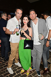 Left to right, Chairman of Atlantic Records BEN COOK, singer MARINA DIAMANDIS and MAX LOUSADA Chairman & CEO of Warner Music UK at the Warner Music Group & GQ Summer Party held at Shoreditch House, Ebor Street, London on 17th July 2014.