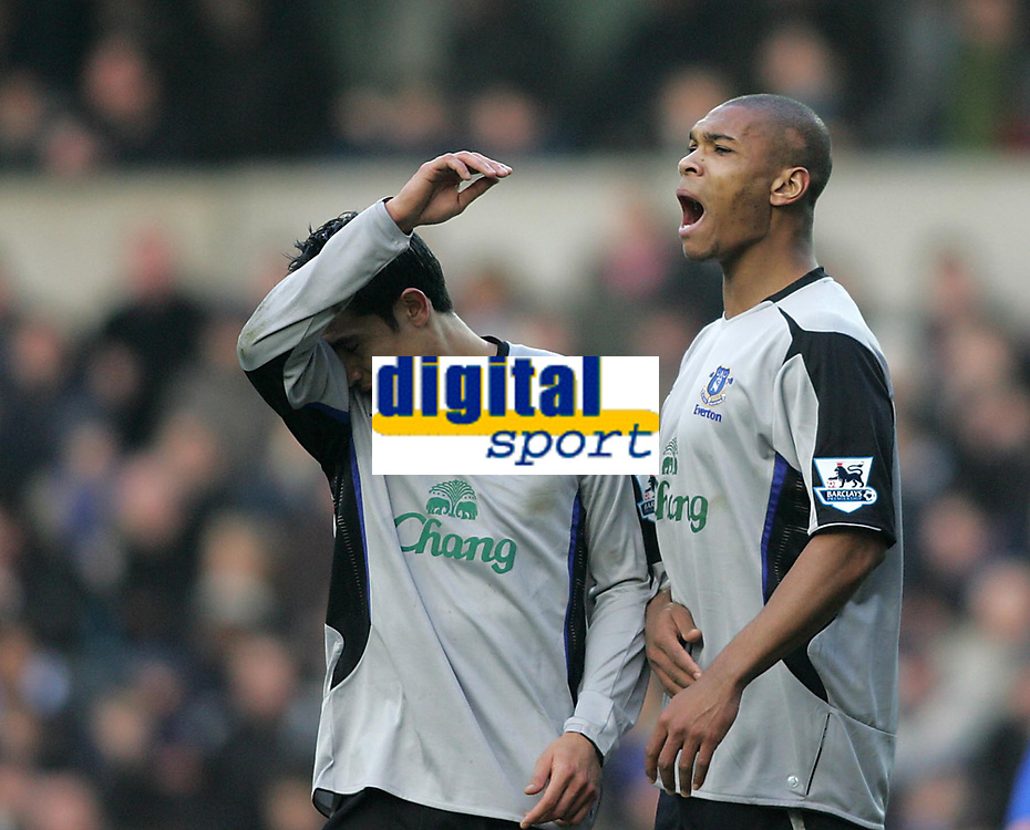 Photo: Lee Earle.<br /> Millwall v Everton. The FA Cup. 07/01/2006.Everton players Tim Cahill (L) and Marcus Bent look dejected after Millwall take the lead.