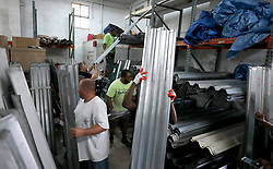September 7, 2017 - Ft. Lauderdale, FL, USA - People load up with hurricane shutters from the Habitat for Humanity Restore on Broward Blvd. There was a line out the door to purchase shutters. (Credit Image: © Mike Stocker/Sun-Sentinel via ZUMA Wire)