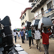 Electronic waste export to Nigeria...Alaba International Market, one of the largest markets for electronic goods in West Africa.  New and old - and a lot of non-working electronic goods such as TVs and computers come in to the market via Lagos harbour from the US, Western Europe and China...The shipment - TV-set originally delivered to municipality-run collecting point in UK for discarded electronic products - was tracked and monitored by Greenpeace using a combination of GPS (Global Positioning System using satellites), GSM (positioning using data from mobile networks to triangulate approximate positions) and an onboard radiofrequency transmitter (used for making triangulations in combination with handheld directional receivers used by team on ground) is placed inside the TV-set.  The TV arrived in Lagos in container no 4629416.