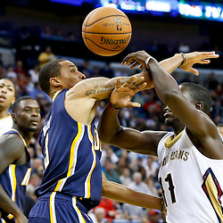 Oct 30, 2013; New Orleans, LA, USA; Indiana Pacers point guard George Hill (3) knocks the ball away from New Orleans Pelicans point guard Jrue Holiday (11) during the second half of a game at New Orleans Arena. The Pacers defeated the Pelicans 95-90. Mandatory Credit: Derick E. Hingle-USA TODAY Sports