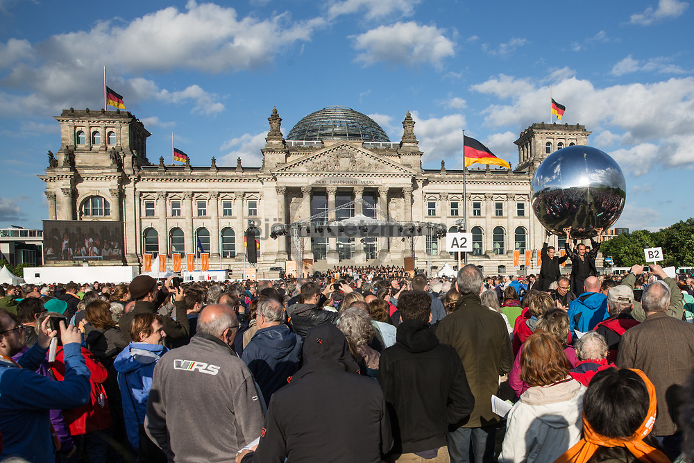 Berlin, Germany - 24.05.2017<br /> <br /> Opening Ceremony infront of the Reichstagsbuilding. Start of the German Protestant Church Assembly (&quot;Deutscher Evangelischer Kirchentag&rdquo;) in Berlin. Tens of thousands attend the ceremonies and concerts at the beginning of the church convention. <br /> <br /> Auftakt-Zeremonie vor dem Reichstagsgebaeude. Start des Deutschen Evangelischer Kirchentags 2017 in Berlin. Zehntausende besuchen die Zeremonien und Konzerte zum Auftakt des Kirchentags<br /> <br />  Photo: Bjoern Kietzmann