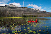 Dave Costello and Parker Meek canoeing on the Turner Lake chain, Tweedsmuir National Park, B.C.