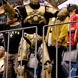 2009 October 18: A New Orleans Saints fan dressed as Master Chief from the video game Halo dances in the stands during a 48-27 win by the New Orleans Saints over the New York Giants at the Louisiana Superdome in New Orleans, Louisiana.