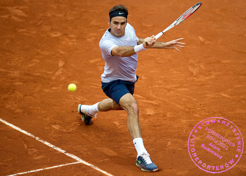 Roger Federer of Switzreland competes in men's singles  while Day Sixth during The French Open 2013 at Roland Garros Tennis Club in Paris, France.<br /> <br /> France, Paris, May 31, 2013<br /> <br /> Picture also available in RAW (NEF) or TIFF format on special request.<br /> <br /> For editorial use only. Any commercial or promotional use requires permission.<br /> <br /> Mandatory credit:<br /> Photo by &copy; Adam Nurkiewicz / Mediasport