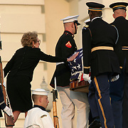 Nancy Regan reaches for the casket of President Reagan as it is taken to the Rotunda of the US Capitol Wednesday, June 9, 2004.  The former president will lie-in-state there until Friday morning...Photo by Khue Bui