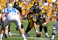 September 4 2010: Iowa Hawkeyes quarterback Ricky Stanzi (12) lines up behind Iowa Hawkeyes offensive linesman James Ferentz (53) during the first quarter of the NCAA football game between the Eastern Illinois Panthers and the Iowa Hawkeyes at Kinnick Stadium in Iowa City, Iowa on Saturday September 4, 2010. Iowa defeated Eastern Illinois 37-7.
