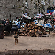 Pro-Russia activists take guard at a barricade near the police station in Slavyansk. The eastern Ukranian city was taken under control by a separatist militia early in the week.