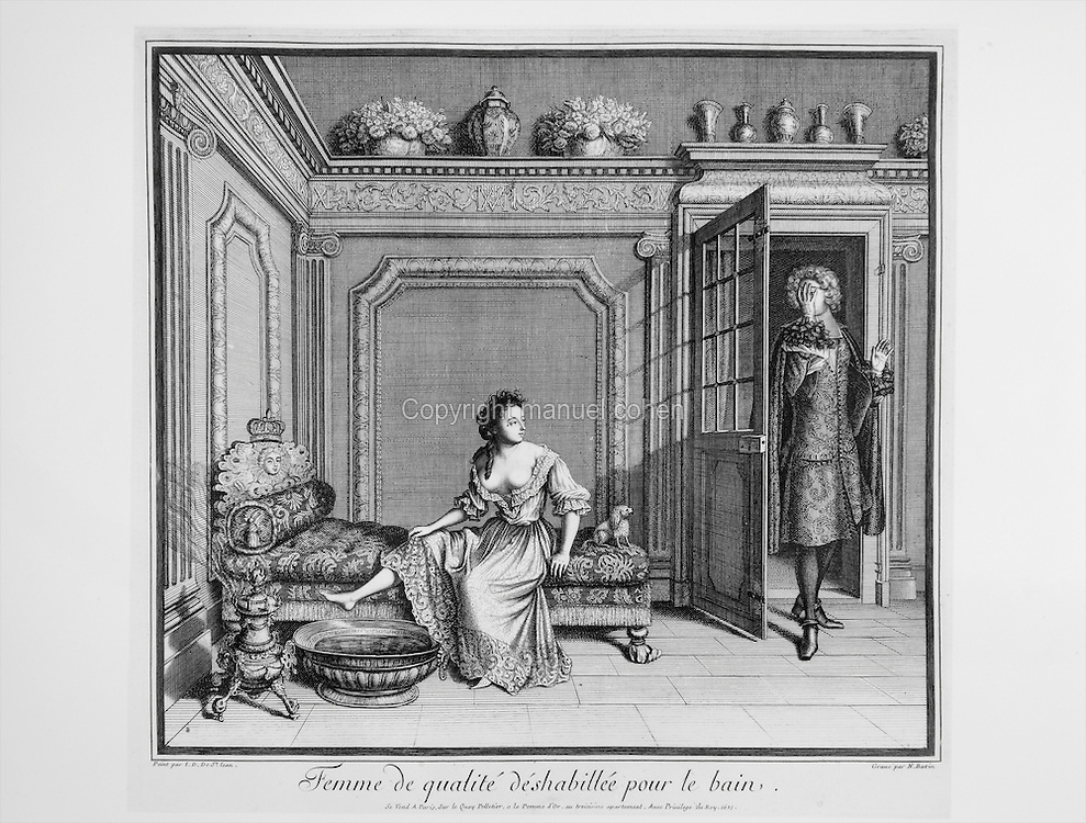 Woman bathing in a state of undress with a man entering the room shielding his face, a scene of life at the Palace of Versailles under king Louis XIV, late 17th century engraving by Nicolas Bazin after a painting by Jean Dieu de Saint Jean Delin. Copyright © Collection Particuliere Tropmi / Manuel Cohen