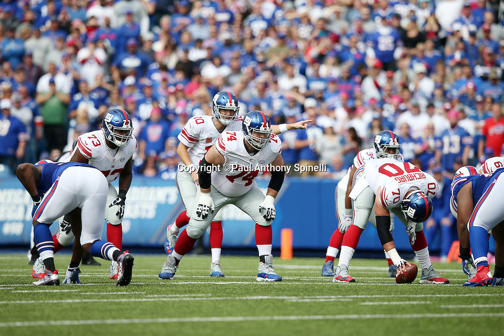 New York Giants center Weston Richburg (70) is about to snap the ball in a shotgun formation as New York Giants guard Geoff Schwartz (74) gets set to block during the 2015 NFL week 4 regular season football game against the Buffalo Bills on Sunday, Oct. 4, 2015 in Orchard Park, N.Y. The Giants won the game 24-10. (©Paul Anthony Spinelli)